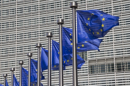 European Union flags outside the European Commission building in Brussels. (Photo: Shutterstock.com)