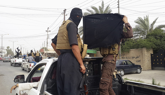 Fighters of the Islamic State of Iraq and al-Sham (ISIS) celebrate in vehicles taken from Iraqi security forces in the city of Mosul, June 12, 2014. (Source: al-Monitor photo by REUTERS)
