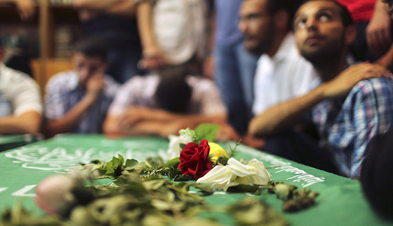 Mourners surround the bodies of Palestinian members of Hamas' armed wing during their funeral at a mosque in Gaza City June 21, 2014. Hamas' armed wing in Gaza said at least six members of its group were killed in the collapse of a tunnel the group had dug close to the border with Israel to infiltrate the Jewish state. (Photo by REUTERS/Mohammed Salem. Source al-Monitor)