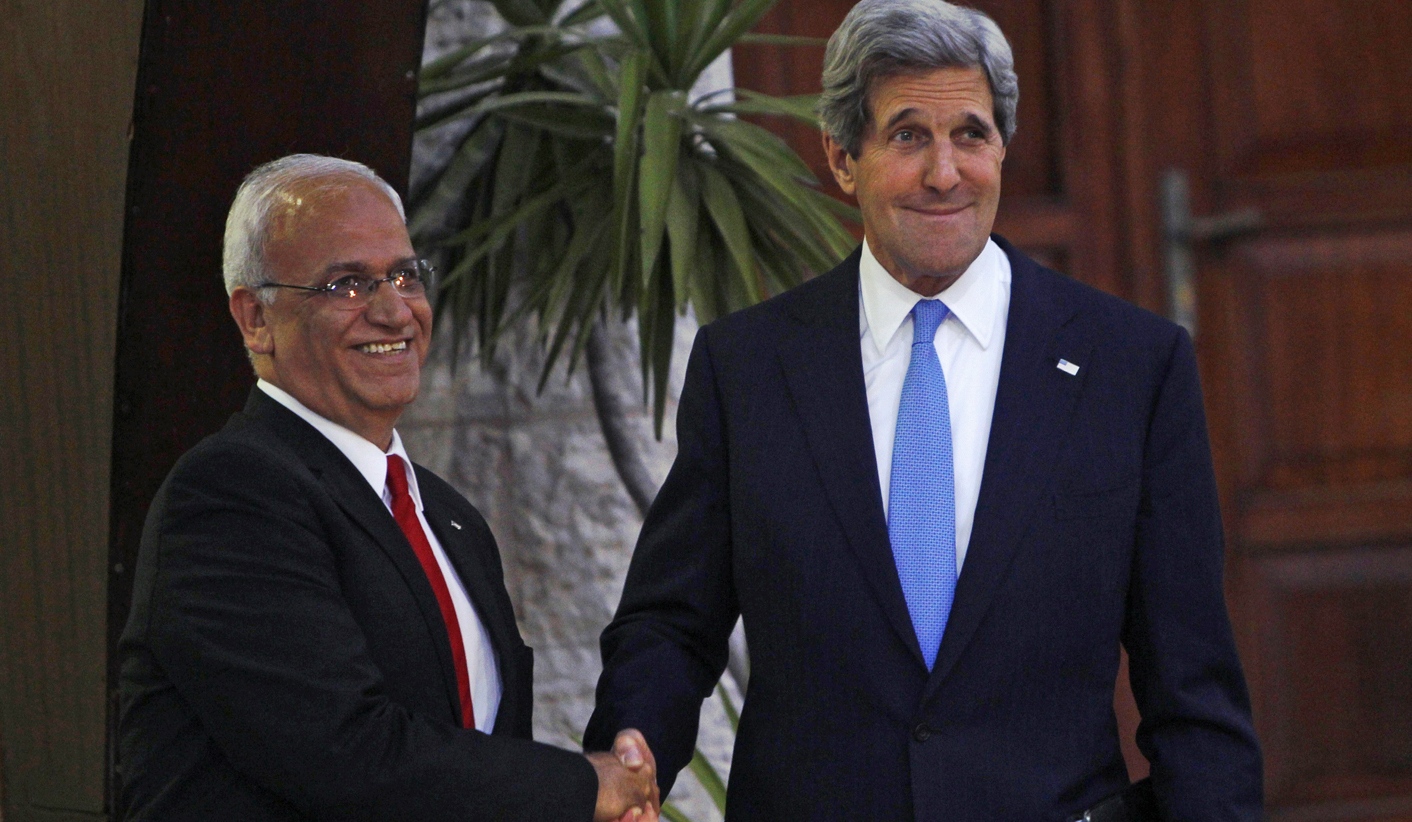 U.S. Secretary of State Kerry shakes hands with Palestinian Chief Negotiator Erekat in the West Bank city of Ramallah