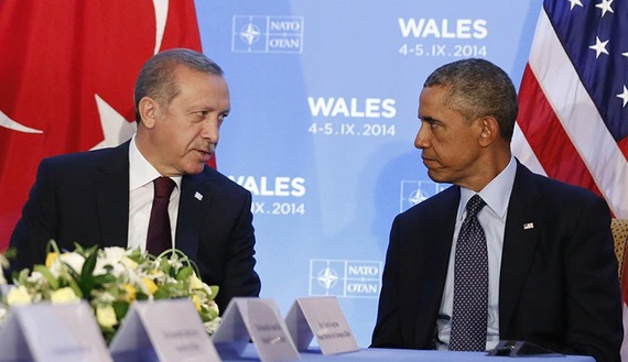 U.S. President Barack Obama listens as he hosts a bilateral meeting with Turkey's President Tayyip Erdogan during the NATO Summit at the Celtic Manor Resort in Newport, Wales September 5, 2014.      REUTERS/Larry Downing   (UNITED KINGDOM - Source: al- Monitor)