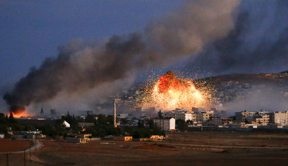 Smoke and flames rise over Syrian town of Kobani after an airstrike, as seen from the Mursitpinar crossing on the Turkish-Syrian border in the southeastern town of Suruc in Sanliurfa province, October 20, 2014. The United States told Turkey that a U.S. military air-drop of arms to Syrian Kurds battling Islamic State near the Syrian town of Kobani was a response to a crisis situation and did not represent a change in U.S. policy, U.S. Secretary of State John Kerry said on Monday.     REUTERS/Kai Pfaffenbach (TURKEY  - Tags: MILITARY CONFLICT POLITICS TPX IMAGES OF THE DAY)   - RTR4AUYL