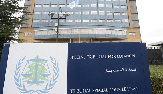 A view of a sign on the exterior of the Special Tribunal for Lebanon in The Hague, The Netherlands, January 16, 2014. The trial in absentia of the four suspects accused of killing Lebanese statesman Rafiq al-Hariri opened in The Hague on Thursday, nine years after the bomb attack in which the former prime minister and 21 others died. REUTERS/Toussaint Kluiters/United Photos (NETHERLANDS - Tags: POLITICS CIVIL UNREST CRIME LAW) - RTX17G3K