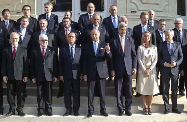 Iraq's President Masum, French President Hollande, French Foreign Minister Fabius and US Secretary of States Kerry pose for a family photo during the International Conference on Peace and Security in Iraq, at the Quai d'Orsay in Paris