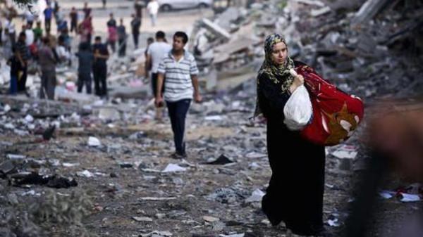 Rifugiati a Gaza City durante l'attacco israeliano della scorsa estate (Foto: AFP)