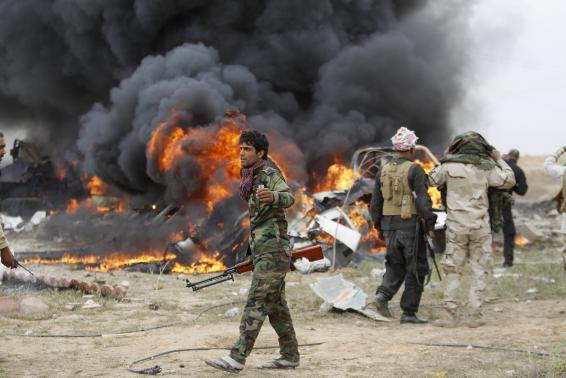 Miliziani sciiti a Tikrit (Foto: REUTERS/Thaier Al-Sudani)