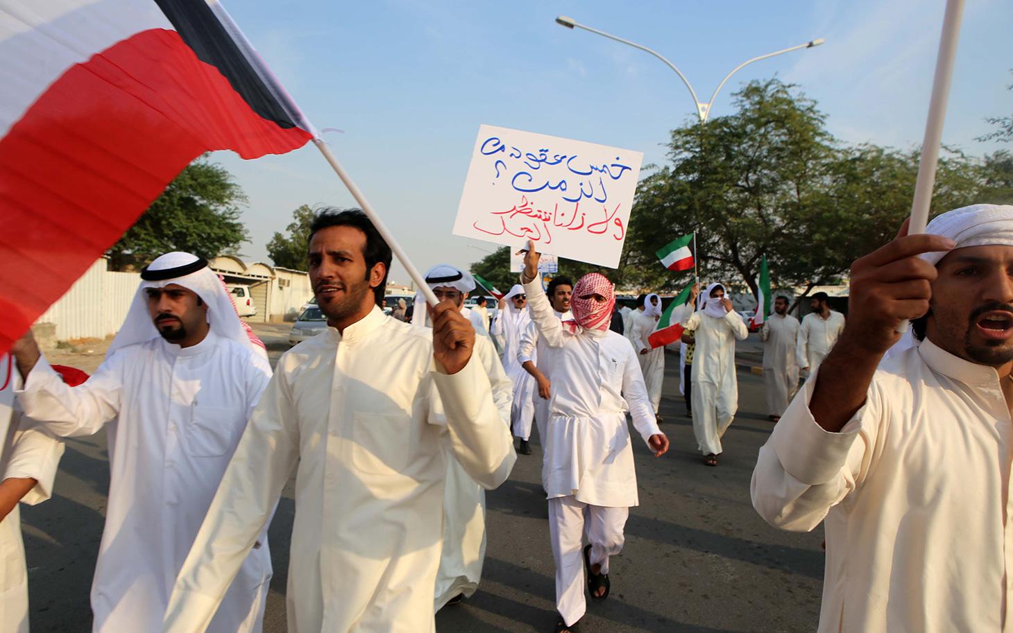 Manifestazione per i diritti del popolo Bidoon. Foto YASSER AL-ZAYYAT/AFP/Getty Images