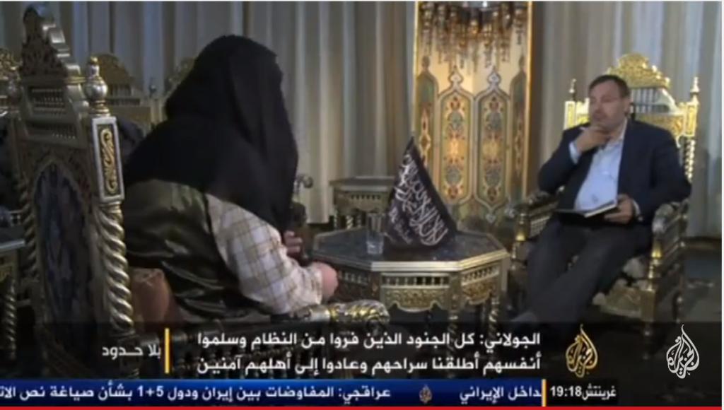 Fermo immagine da al Jazeera dell'intervista ad Abu Mohammed al Julani