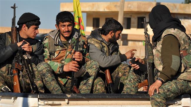 Combattenti kurdi a Tal Hamis (Foto: AFP)