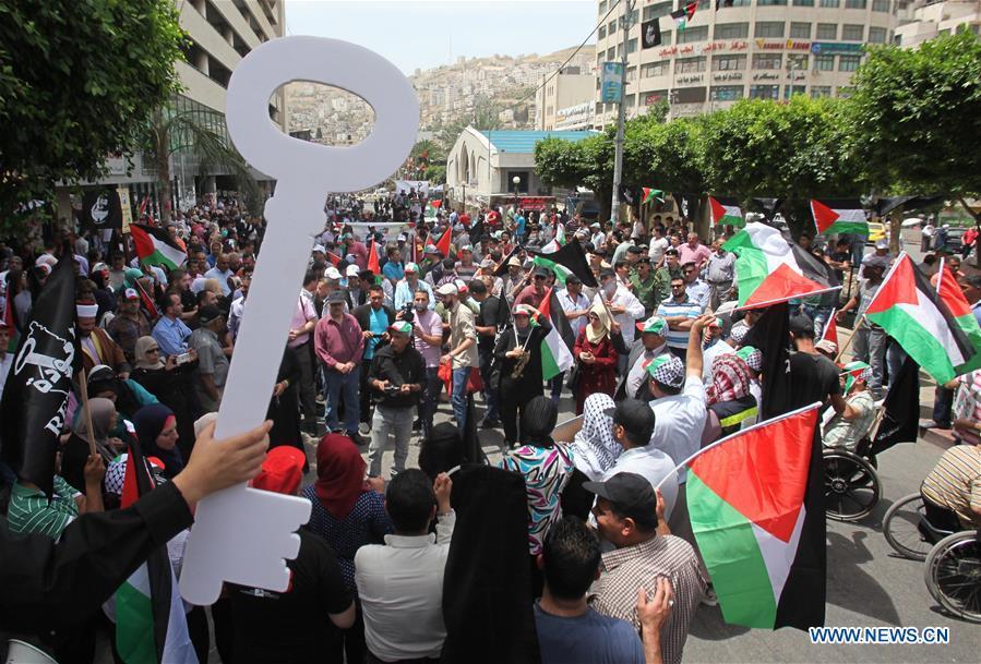 Manifestazione in ricordo della Nakba ieri nella città palestinese di Nablus, Cisgiordania. (Xinhua/Nidal Eshtayeh)