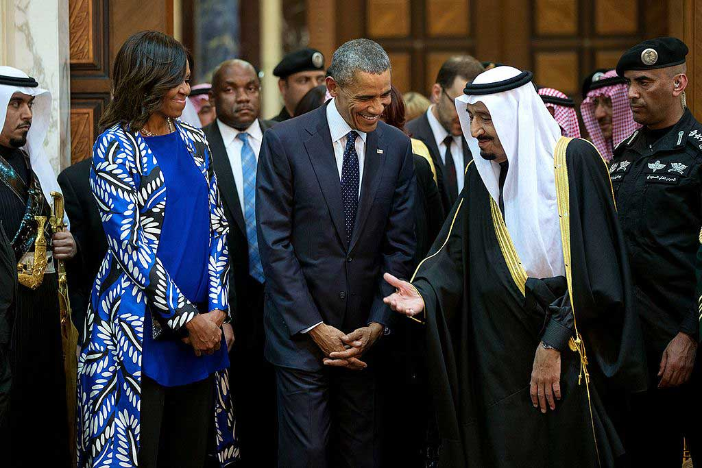 President Barack Obama and First Lady Michelle Obama walk with King Salman bin Abdulaziz of Saudi Arabia at Erga Palace in Riyadh, Saudi Arabia. (Pete Souza/White House)