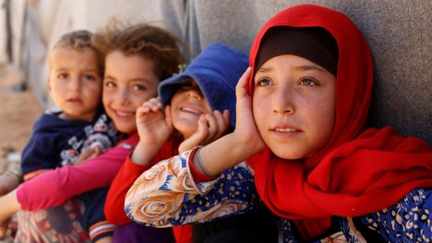Bambini siriani nel campo profughi di Azraq, Giordania. (Foto:Muhammad Hamed/Reuters)