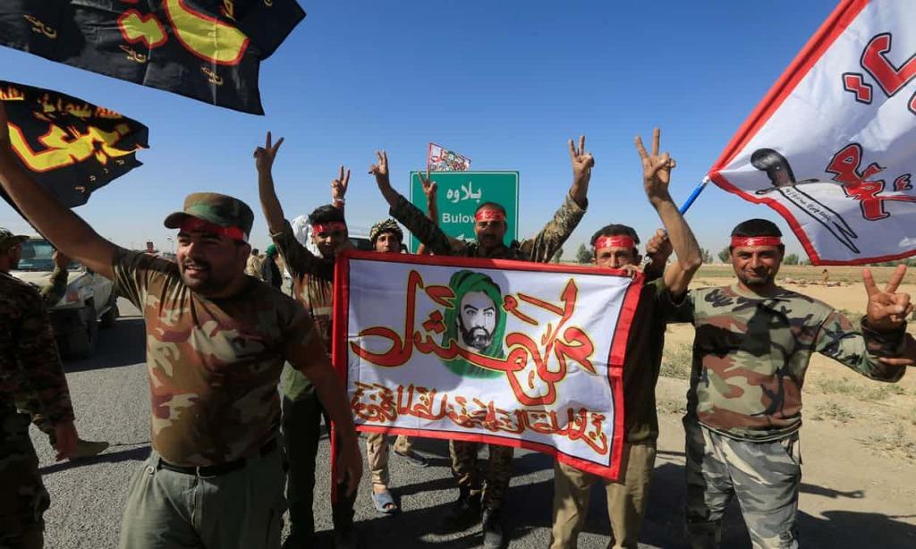 Forze di mobilitazione popolare festeggiano la presa di Kirkuk. (Foto: Reuters)