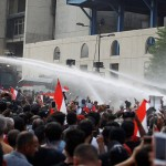 IRAQ. Terzo giorno di proteste, 13 uccisi e Baghdad sotto coprifuoco